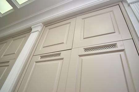 Wardrobe doors with ventilation grilles. Classic interior