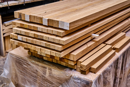 Woodworking and joinery production. Glued oak wood panels for wooden bed. Furniture manufacture Imagens