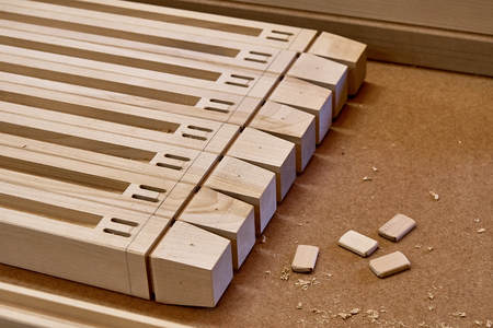 Woodworking and carpentry production. Wooden elements of a children's bed. Furniture manufacture. Close-up