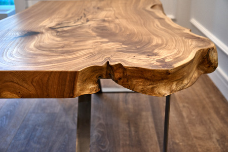 Woodworking and carpentry production. Elm slab coffee table. Close-up. Furniture manufacture