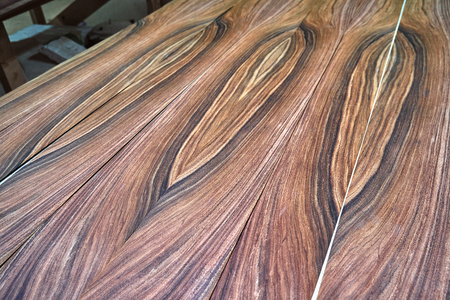 Veneer Santos Rosewood. Wood texture. Woodworking and carpentry production. Close-up. Furniture manufacture Stock Photo