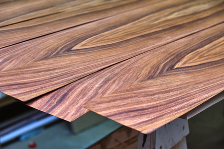 Veneer Santos Rosewood. Wood texture. Woodworking and carpentry production. Close-up. Furniture manufacture 写真素材