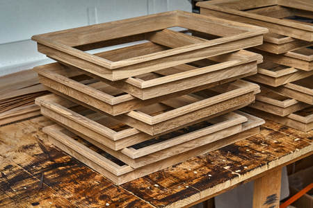 Wood door manufacturing process. Wooden moldings for the entrance door. Woodworking and carpentry production. Furniture manufacture. Close-up Imagens