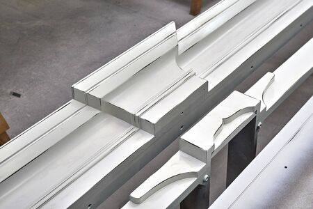 Crown molding of a classic wardrobe in process of production in workshop. Furniture manufacture. Close-up
