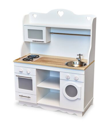 Children white colored and wooden toy kitchen set with cooking oven and washing machine isolated on white background