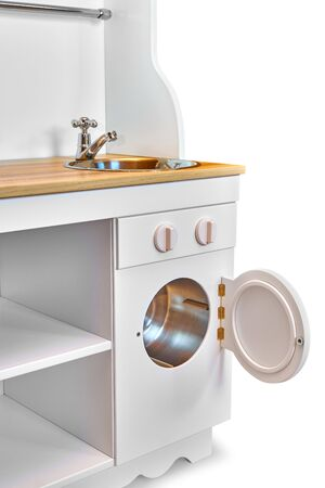 Children white colored and wooden toy kitchen set with cooking oven and washing machine isolated on white