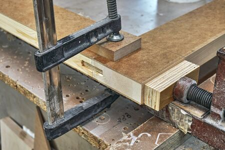 Joinery. Wood door manufacturing process. Clamping and gluing door leaf. Woodworking and carpentry production. Furniture manufacture. Close-up