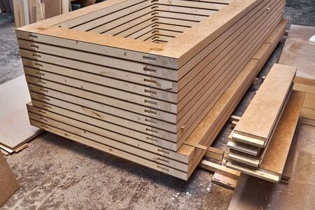 Joinery. Wood door manufacturing process. Stacked door leafs. Woodworking and carpentry production. Furniture manufacture. Close-up Standard-Bild