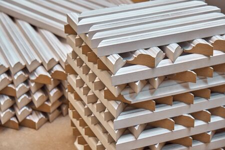 Joinery. Wood door manufacturing process. Stacked door moldings. Woodworking and carpentry production. Furniture manufacture. Close-up