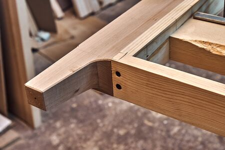 Joinery. Wooden headboard building process. Wooden furniture manufacturing process. Furniture manufacture. Close-up
