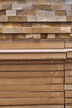 Stacked wooden edge-glued panel and blockboard panels in process of production in workshop. Furniture manufacture. Close-up