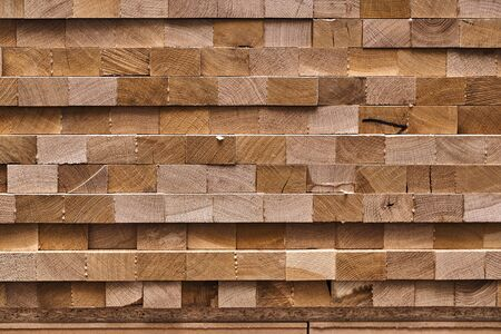 Stacked wooden edge-glued panels in process of production in workshop. Furniture manufacture. Close-up