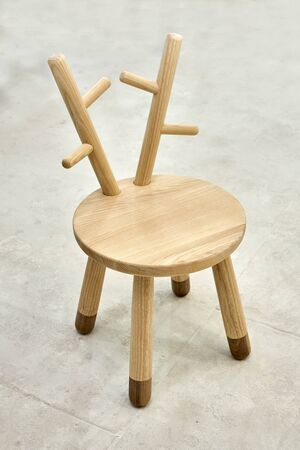 New creative small chair for kids made of solid ash and walnut tree in painting chamber. Wooden furniture