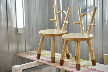 New creative small chairs for kids made of solid ash and walnut tree in painting chamber. Wooden furniture