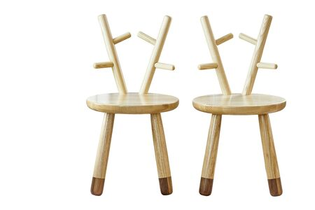 New creative small chairs for kids made of solid ash and walnut tree on a white background. Wooden furniture Imagens