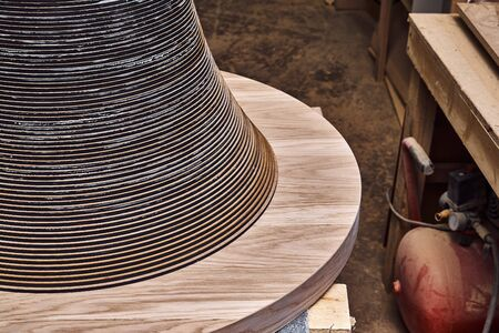 Joinery. Wooden coffee table in shape of circle being produced in workshop