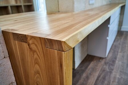 Live edge counter top. Wooden live edge table in solid elm. Solid elm countertop. Details furniture. Loft style boudoir table