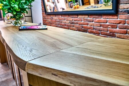 Wooden live edge table in solid oak. Solid oak countertop. Live edge counter top. Details furniture. Solid oak reception