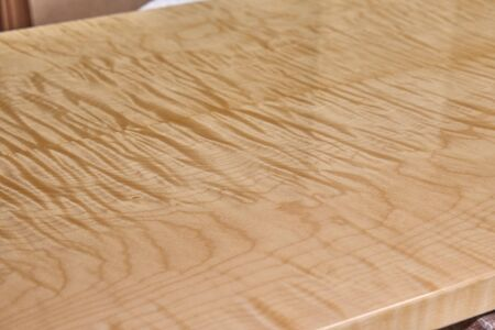 Sycamore maple cabinet door in workshop. High gloss cabinet door. Furniture manufacture. Close-up Reklamní fotografie