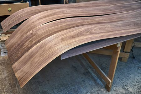 Walnut veneer. Wood texture. Woodworking and carpentry production. Close-up. Furniture manufacture