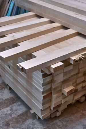 Wooden table legs. Stacked wooden table legs in workshop. Furniture manufacture