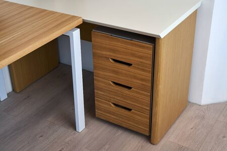 Wooden office desk and storage cabinet with drawers. Wooden office furniture. Modern furniture Reklamní fotografie