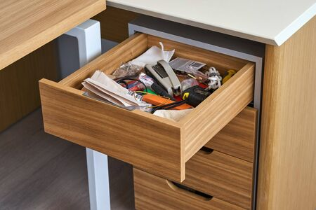 Wooden storage cabinet with open drawer. Wooden office furniture. Modern furniture
