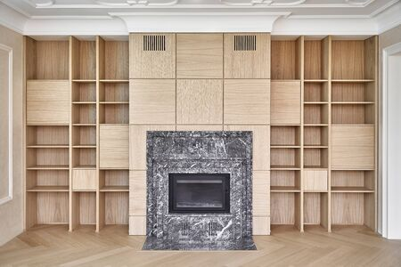 Wooden bookshelves. Wooden shelving around the fireplace. Furniture manufacture. Close-up 免版税图像