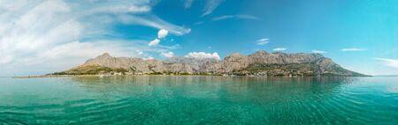 Panoramic view Omis town from the sea. Croatia, Dolmatia 免版税图像