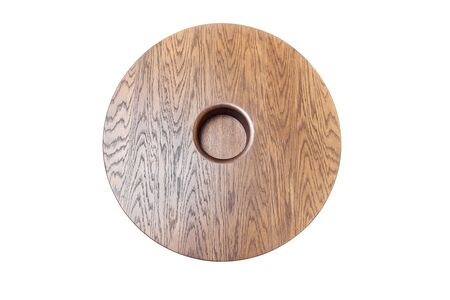 Wooden coffee table in shape of circle being on white background. View from above 免版税图像