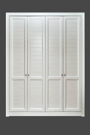 Classic style wardrobe. White classic wardrobe isolated on gray background. Furniture manufacture. 免版税图像
