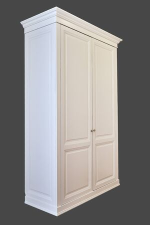 Classic style wardrobe. White classic wardrobe isolated on gray background. Wardrobe with crown molding