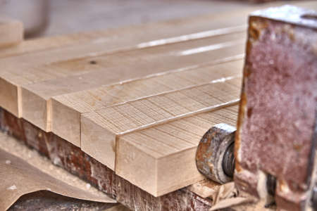 Joinery. Gluing and clamping wooden panels. Wooden furniture manufacturing process. Furniture manufacture. Close-up