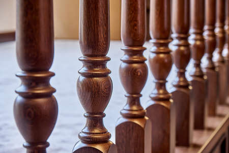 Perspective view of detail of ornate wooden balustrade in contemporary house with classic interior 版權商用圖片