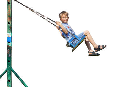 Side view of dissatisfied boy in casual clothes frowning and looking away while riding weathered swing isolated on white background Stok Fotoğraf