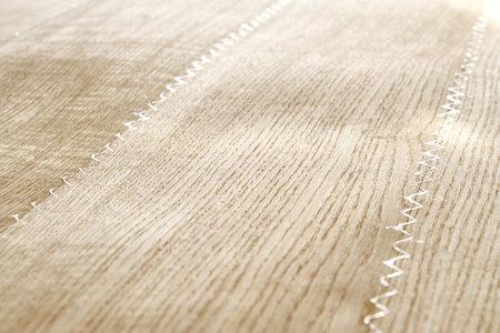 Oak texture as background. Spliced oak veneer with glue thread for furniture manufacturing closeup