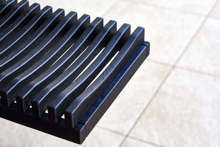 Stylish dishes drying rack made of toned black solid ash in summer kitchen extreme close view