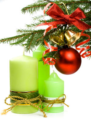 Christmas fir, ball, ribbon, bells and candles on a white background Stock Photo - 6090152