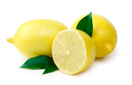Three ripe lemons with sheet on white background