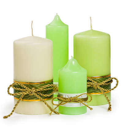 Candles with a golden ribbon Stock Photo