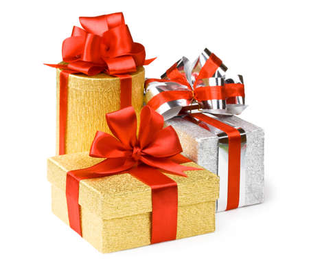 Gold and silver boxes with gifts and bows Фото со стока