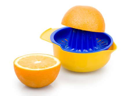 plastic squeezer and oranges photo