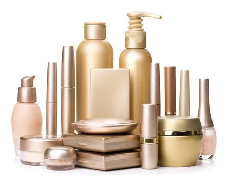 Cosmetici glamour isolato su uno sfondo bianco. Cosmetici Oro Archivio Fotografico - 20480473