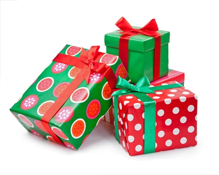 Boxes with gifts tied with red ribbon and bows isolated on white background