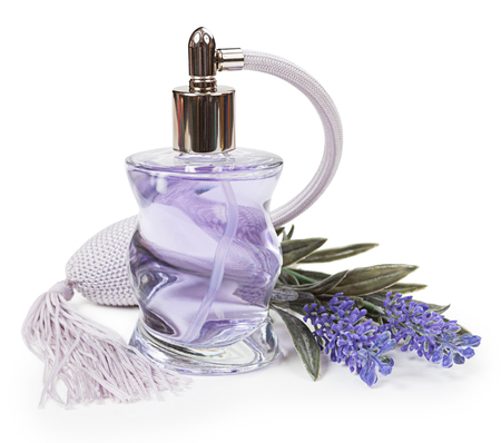 Perfume in the bottle and lavender pulverizer isolated on white background