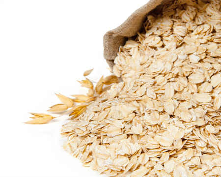 Oat flake isolated on white background Foto de archivo