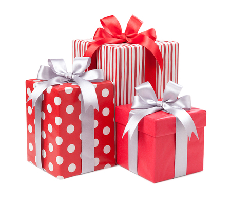 Red boxes with gifts tied with gray bows isolated on white background Фото со стока