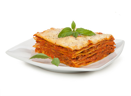 Tasty lasagna isolated on plate Foto de archivo