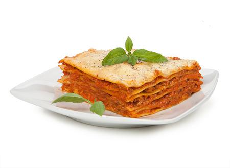 Tasty lasagna isolated on plate Archivio Fotografico