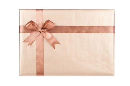 Gift box with gifts and brown bow. Foto de archivo